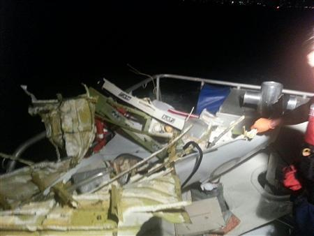 The wreckage of a plane that crashed is brought aboard a U.S. Coast Guard boat off the coast of Fort Lauderdale