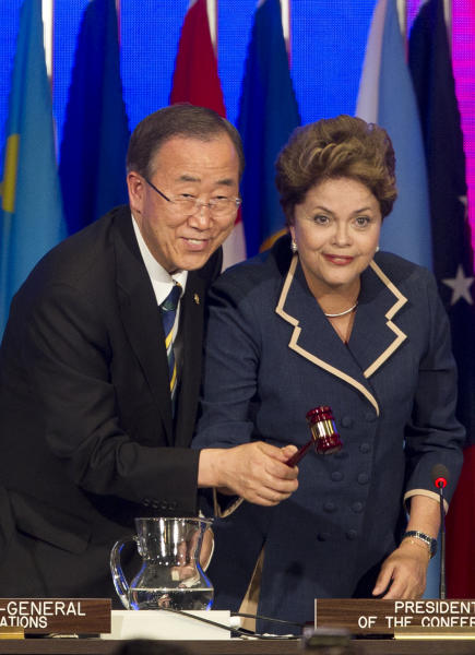 Brazil's President Dilma Rousseff, right, and United Nations Secretary General Ban Ki-Moon hold the gavel together as they close the Rio+20 UN Conference on Sustainable Development in Rio de Janeiro, Brazil, Friday, June 22, 2012. (AP Photo/Andre Penner)