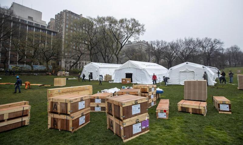 An emergency field hospital equipped with a respiratory unit goes up outside Mount Sinai hospital in New York's Central Park.