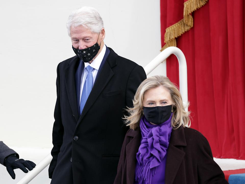 Former president Bill Clinton arrives with former Secretary of State Hillary Clinton for the inauguration of Joe Biden as the 46th President of the United States on the West Front of the CapitolGetty Images