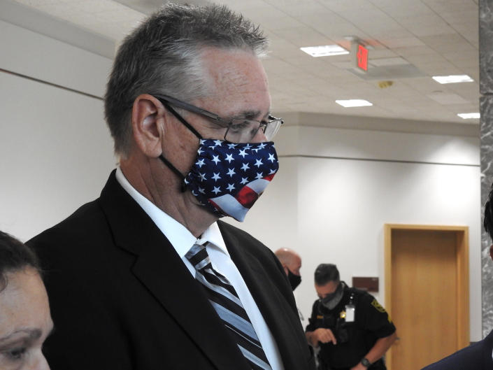 Former Broward County Deputy Scot Peterson who was on duty during the Marjory Stoneman Douglas High School shooting in 2018 and his lawyer Mark Eiglarsh (not pictured) appeared in court Wednesday, Aug. 18, 2021, in Fort Lauderdale, Fla. The former school resource officer accused of hiding during a South Florida school shooting that left 17 people dead said after a hearing Wednesday that he never would have sat idle if he had known people were being killed. (Rafael Olmeda/South Florida Sun-Sentinel via AP)