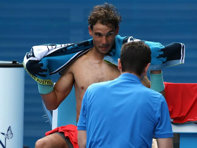 Rafael Nadal of Spain dries himself with a towel during his fourth round match against Kei Nishikori of Japan at the Australian Open tennis championship in Melbourne, Australia, Monday, Jan. 20, 2014.(AP Photo/Aaron Favila)