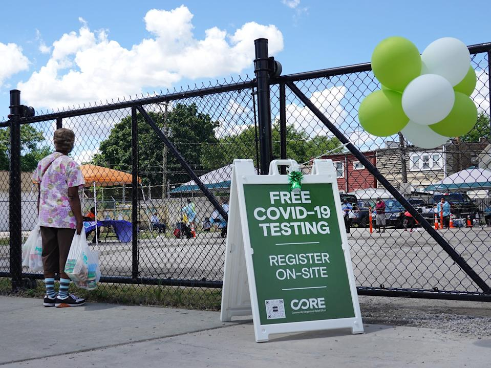 A sign alerts residents to a mobile COVID-19 testing site set up on a vacant lot in the Austin neighborhood on June 23, 2020 in Chicago, Illinois. The site is one of four mobile testing sites, two community-based sites and two first-responder-focused sites being implemented by the city.