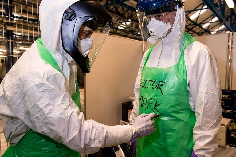 Doctors and nurses wear protective equipment during a training exercise at the Army Medical Services Training Centre (AMSTC), at Strensall near York to help tackle Ebola in West Africa on October 7, 2014 (AFP Photo/GRAHAM HARRISON)