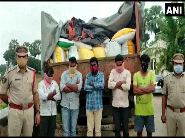 Police personnel with the truck loaded with the PDS rice, along with the accused. [Photo/ANI]