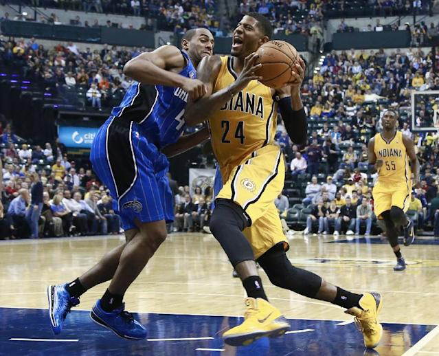 Indiana Pacers forward Paul George (24) moves to the basket as Orlando Magic guard Arron Afflalo defends in the second half of an NBA basketball game in Indianapolis, Tuesday, Oct. 29, 2013. The Pacers won 97-87. (AP Photo/R Brent Smith)