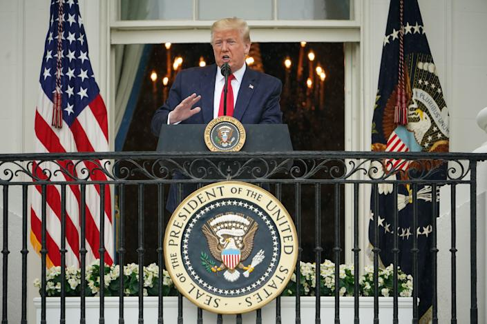 President Trump speaks from the Truman Balcony at the White House. (Mandel Ngan/AFP via Getty Images)