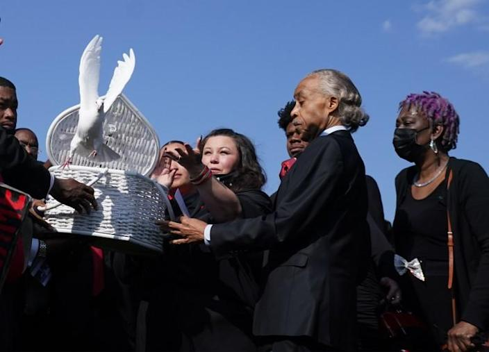 MINNEAPOLIS April 22, 2021.Daunte Wright's funeral came just days after a Minneapolis jury convicted another white former police officer. Katie Wright released doves after the funeral, beside her is Rev. Al Sharpton.