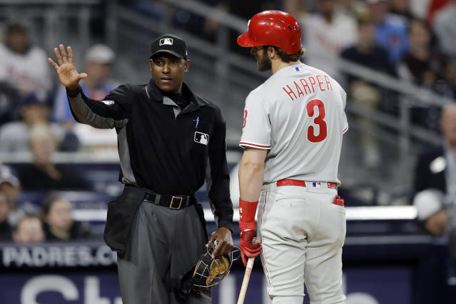 Philadelphia Phillies' Bryce Harper (3) talks with home plate umpire Ramon De Jesus after striking out during the eighth inning of a baseball game against the San Diego Padres, Monday, June 3, 2019, in San Diego. (AP Photo/Gregory Bull)