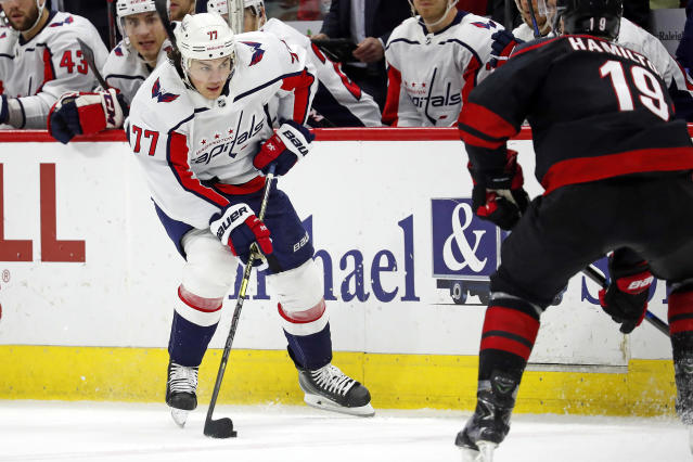 Washington Capitals' T.J. Oshie (77) brings the puck up the ice against the Carolina Hurricanes during the third period of an NHL hockey game in Raleigh, N.C., Friday, Jan. 3, 2020. (AP Photo/Karl B DeBlaker)
