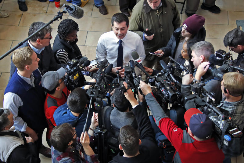 Democratic presidential candidate former South Bend, Ind., Mayor Pete Buttigieg, top center, talks me media following a town hall meeting at the University of Dubuque in Dubuque, Iowa, Wednesday, Jan. 22, 2020. (AP Photo/Gene J. Puskar)