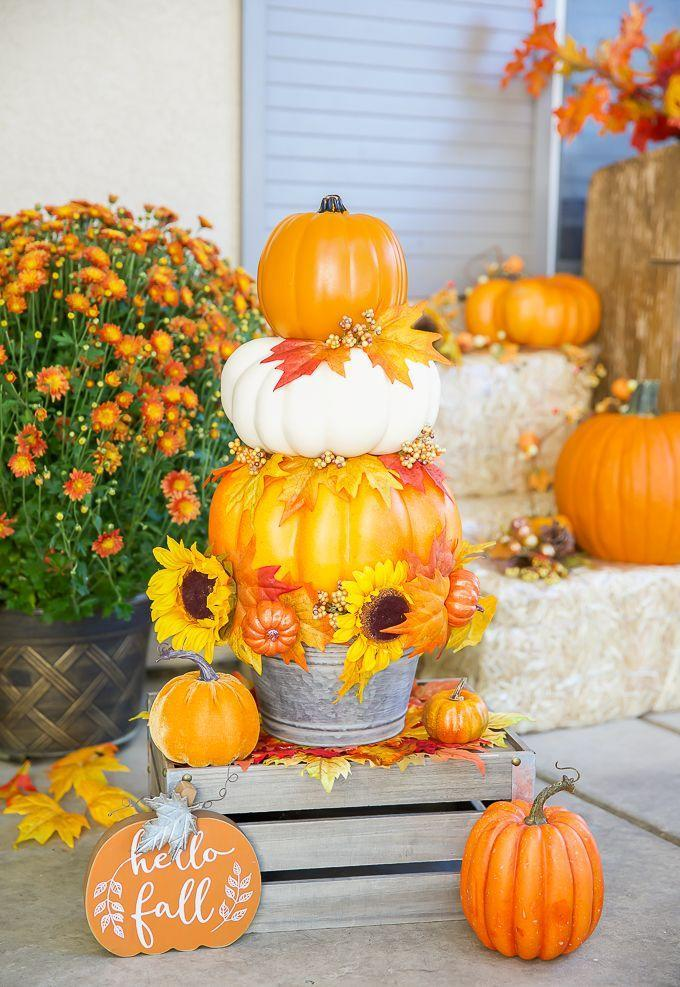 """<p>Add height to your planters by crafting topiaries out of pumpkins. Just be sure to use faux gourds if you want your creation to last all season. </p><p><a class=""""link rapid-noclick-resp"""" href=""""https://apumpkinandaprincess.com/diy-pumpkin-topiary/"""" rel=""""nofollow noopener"""" target=""""_blank"""" data-ylk=""""slk:GET THE TUTORIAL"""">GET THE TUTORIAL</a></p>"""