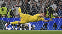 Italy's goalkeeper Gianluigi Donnarumma makes a save against England's Jadon Sancho during penalty shootout of the Euro 2020 soccer championship final match between England and Italy at Wembley Stadium in London, Sunday, July 11, 2021. (Paul Ellis/Pool via AP)