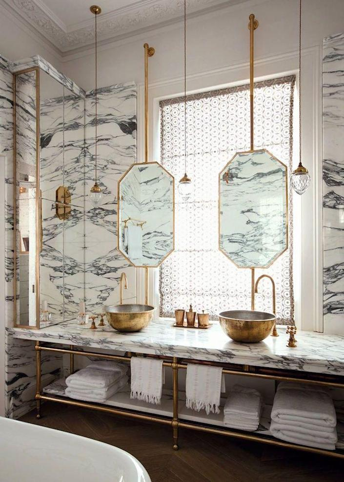 Bold marble patterns like these bring elegance and visual interest to any bathroom they're in.
