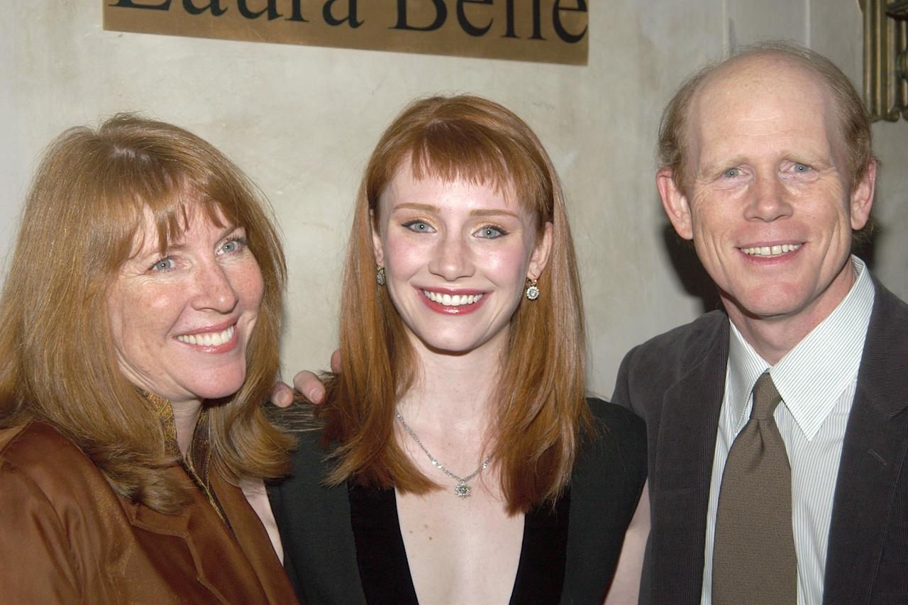 <p>Howard posed with her naturally red hair alongside her parents in 2003.</p>
