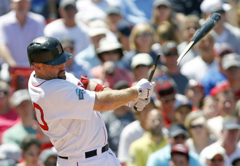 Boston Red Sox's Kevin Youkilis breaks his bat on a single in the second inning of an interleague baseball game against the Atlanta Braves in Boston, Sunday, June 24, 2012. (AP Photo/Michael Dwyer)