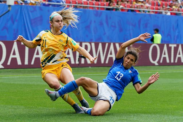 Ellie Carpenter of Australia and Elisa Bartoli of Italy battle for the ball during the 2019 FIFA Women's World Cup France group C match between Australia and Italy at Stade du Hainaut on June 9, 2019 in Valenciennes, France. (Photo by TF-Images/Getty Images)