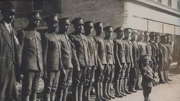 This image shows members of the No. 2 Construction Battalion lined up in Truro, N.S., before they departed for England and France. (Submitted by George Borden - image credit)