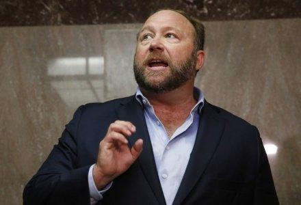 Alex Jones of Infowars talks to the media while visiting the U.S. Senate's Dirksen Senate office building as Twitter CEO Jack Dorsey testifies before a Senate Intelligence Committee hearing on Capitol Hill in Washington, U.S., September 5, 2018. REUTERS/Jim Bourg/File Photo
