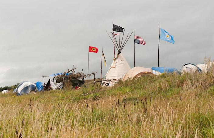 <p>Tepees stand in the Seven Council camp where protesters who oppose the Dakota Access oil pipeline near the Standing Rock Sioux reservation have gathered, in Cannon Ball, N.D., on Sept. 7, 2016. (Photo: Andrew Cullen/Reuters) </p>