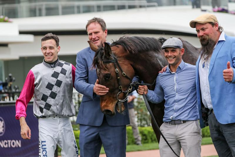 Jockey Jordan Childs, trainer Paul Preusker and team with Surprise Baby after winning the The Bart Cummings at Flemington to qualify for the Melbourne Cup. Source: Racing Photos/Getty Images