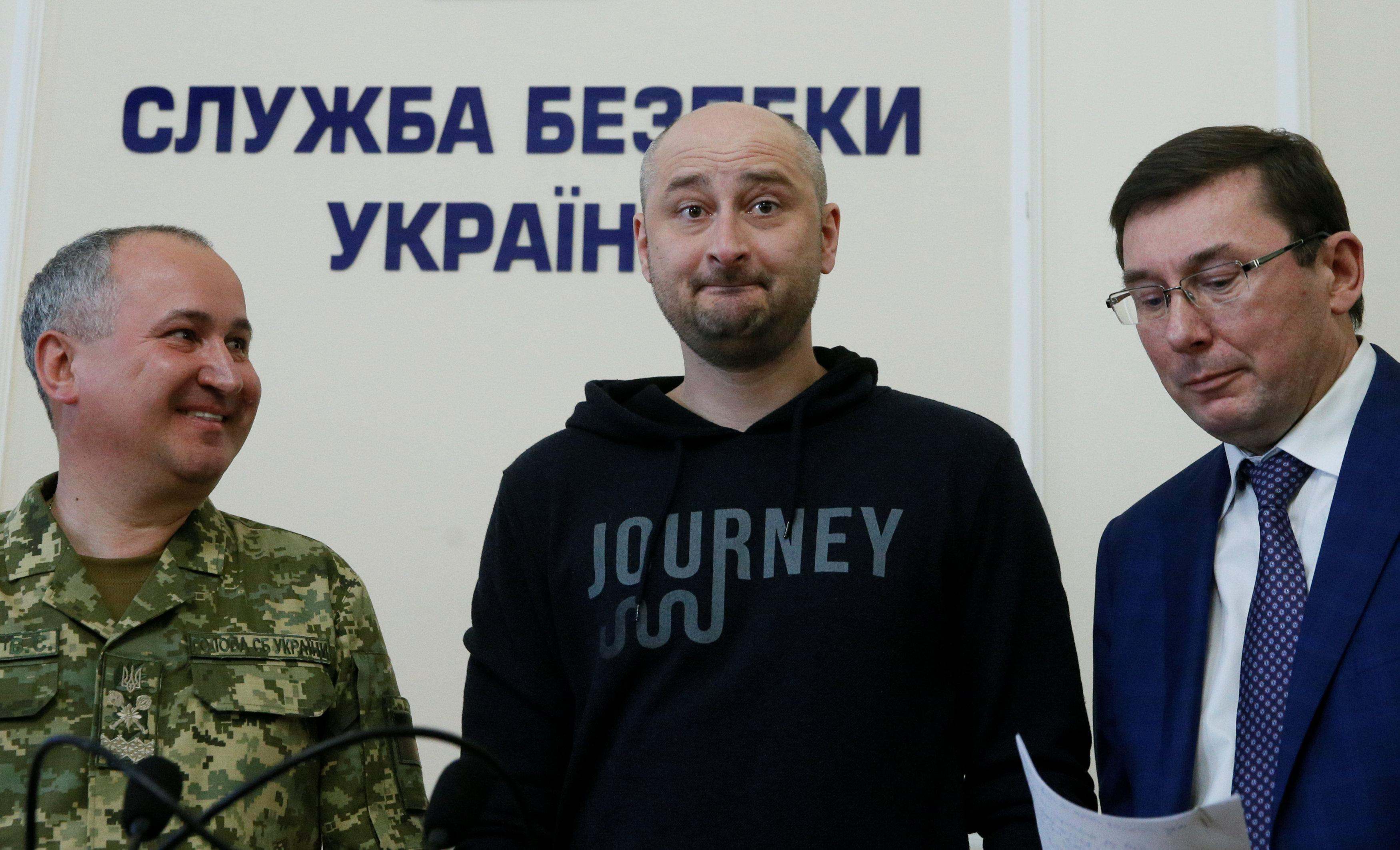 Russian journalist Arkady Babchenko (C), who was reported murdered in the Ukrainian capital on May 29, Ukrainian Prosecutor General Yuriy Lutsenko (R) and head of the state security service (SBU) Vasily Gritsak attend a news briefing in Kiev (Reuters)
