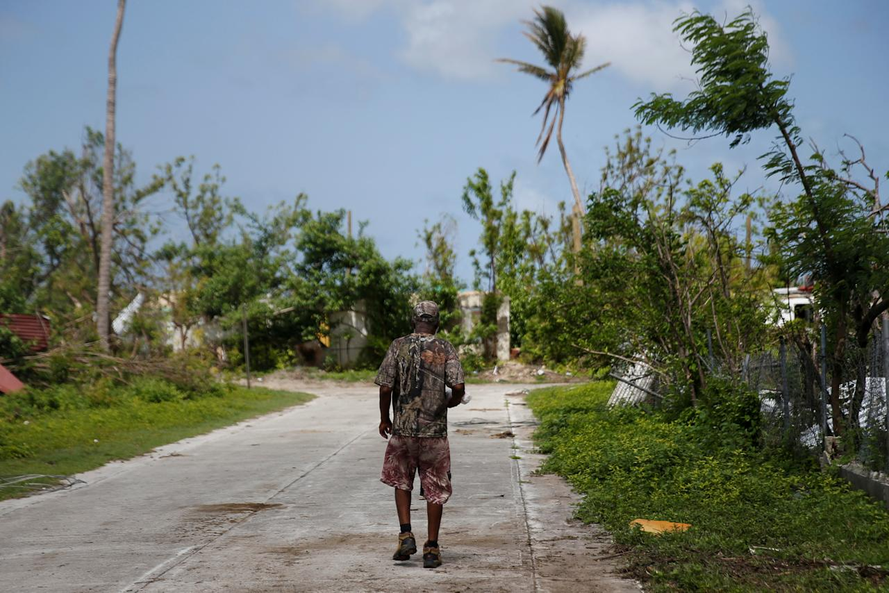 <p>A man walks down a street at Codrington on the island of Barbuda just after a month after Hurricane Irma struck the Caribbean islands of Antigua and Barbuda, October 7, 2017. REUTERS/Shannon Stapleton </p>