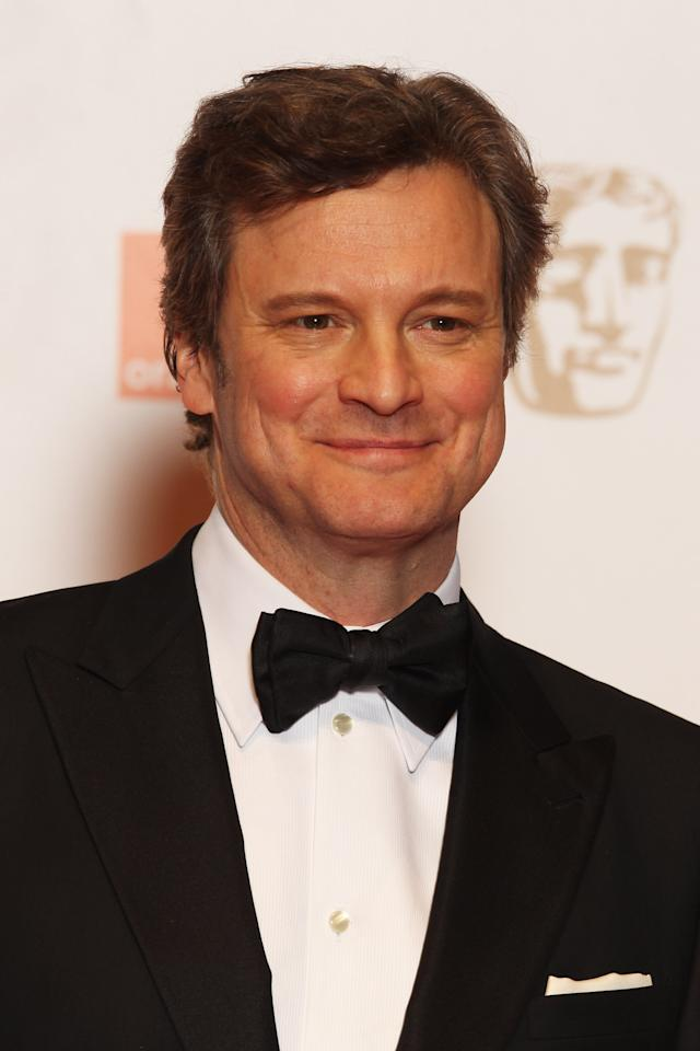 LONDON, ENGLAND - FEBRUARY 12:  (UK TABLOID NEWSPAPERS OUT) Colin Firth poses in the press room at The Orange British Academy Film Awards 2012 at The Royal Opera House on February 12, 2012 in London, England.  (Photo by Dave Hogan/Getty Images)