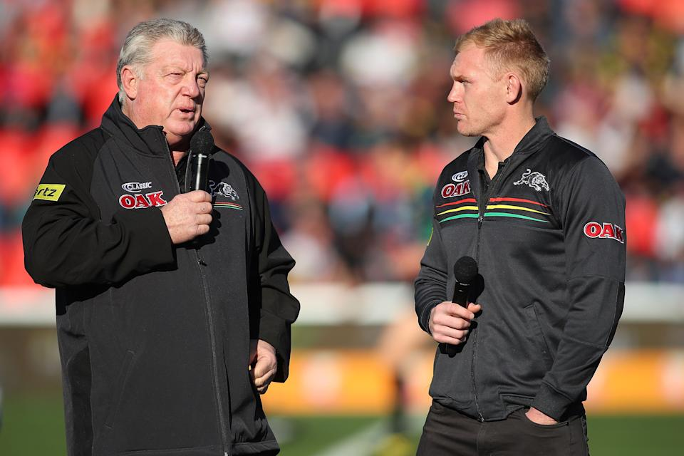 Phil Gould (pictured left) talks with Peter Wallace (pictured right) before a game.