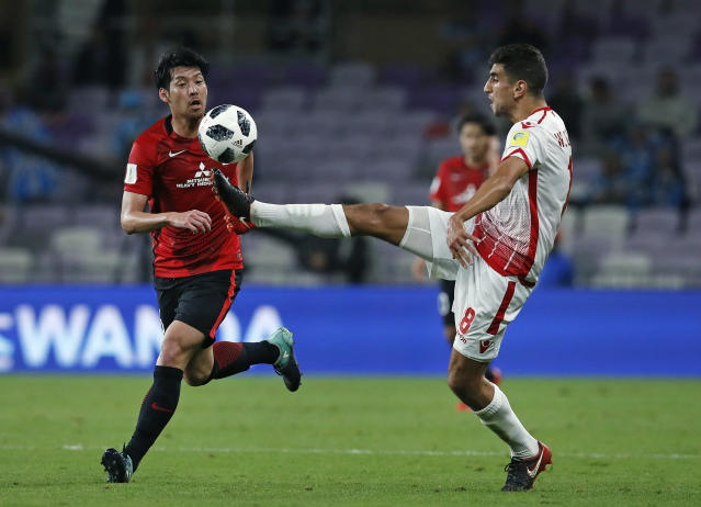 Morocco's Wydad Athletic Club Walid El Karti, right, controls the ball challenged by Japan's Urawa Reds Takuya Aoki during the Club World Cup soccer match for the fifth place between Wydad Athletic Club and Urawa Reds at the Hazza Bin Zayed stadium in Al Ain, United Arab Emirates, Tuesday, Dec. 12, 2017. (AP Photo/Hassan Ammar)