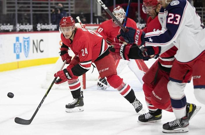 Carolina Hurricanes' Jake Bean (24) chases down the puck during the first period against Columbus on Saturday, March 20, 2021 at PNC Arena in Raleigh, N.C.