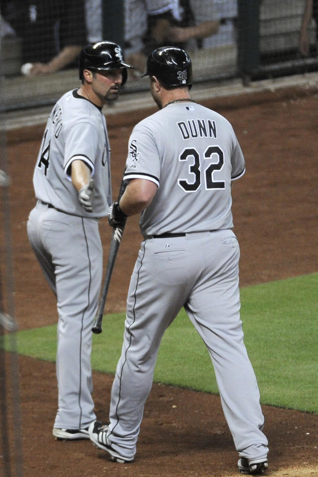Chicago White's Sox Paul Konerko (14) congratulates Adam Dunn (32) on his sacrifice fly ball to score Konerko from third base in the fourth inning of a baseball game against the Houston Astros, Friday, June 14, 2013, in Houston. (AP Photo/Pat Sullivan)
