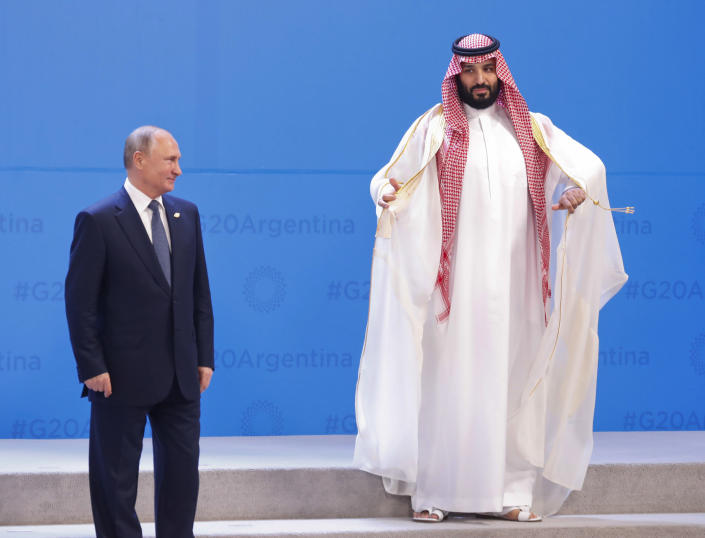 Russia's President Vladimir Putin, left, and Saudi Arabia's Crown Prince Mohammed bin Salmanr wait for other heads of state for a group photo at the start of the G-20 summit in Buenos Aires, Argentina, on Friday. (Photo: AP/Pablo Martinez Monsivais)
