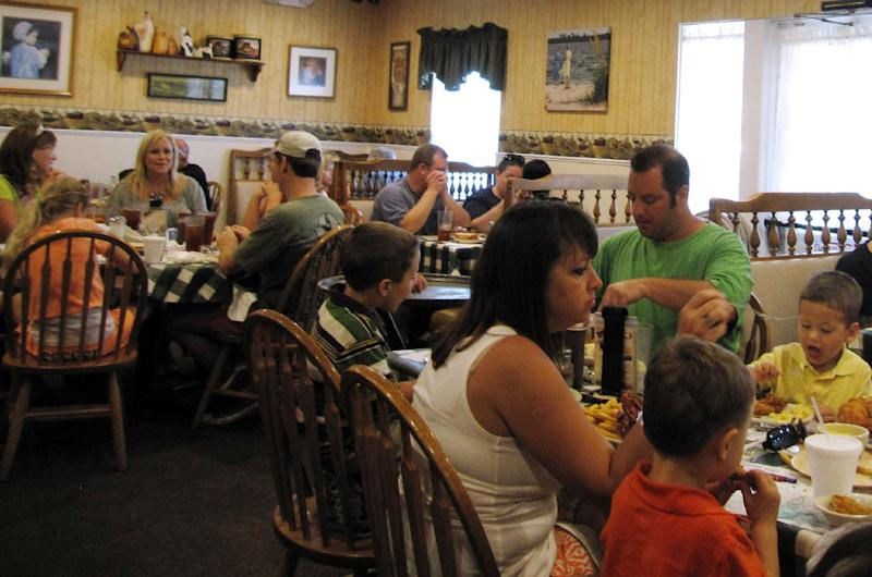 """This Oct. 12, 2013 photo shows customers eating at Yoder's Restaurant in Sarasota, Fla. The restaurant serves """"homestyle Amish food"""" and is extremely popular among locals and tourists alike. (AP Photo/Beth J. Harpaz)"""
