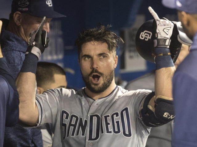 San Diego Padres Austin Hedges celebrates in the dugout after he hit a home run against the Toronto Blue Jays during the third inning of a baseball game Friday, May 24, 2019, in Toronto. (Fred Thornhill/The Canadian Press via AP)
