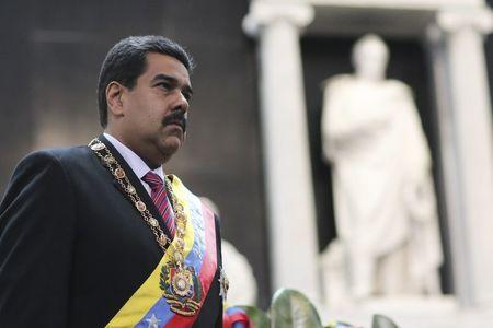 Venezuela's President Nicolas Maduro attends a ceremony at the National Pantheon to commemorate the 185th anniversary of the death of the national hero Simon Bolivar in Caracas