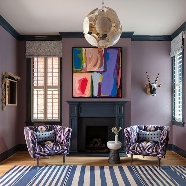 """With two small boys and dogs, Lindsay couldn't be too precious when decorating. She used performance fabrics and had all of her other fabrics and rugs treated for stain resistance. """"With a family, you just have to do that stuff,"""" she says. Lindsay mixed a custom lilac wall color that is trimmed with Farrow & Ball Hague Blue. Arteriors' chairs are upholstered in her Navy Chartreuse Belgian Linen."""