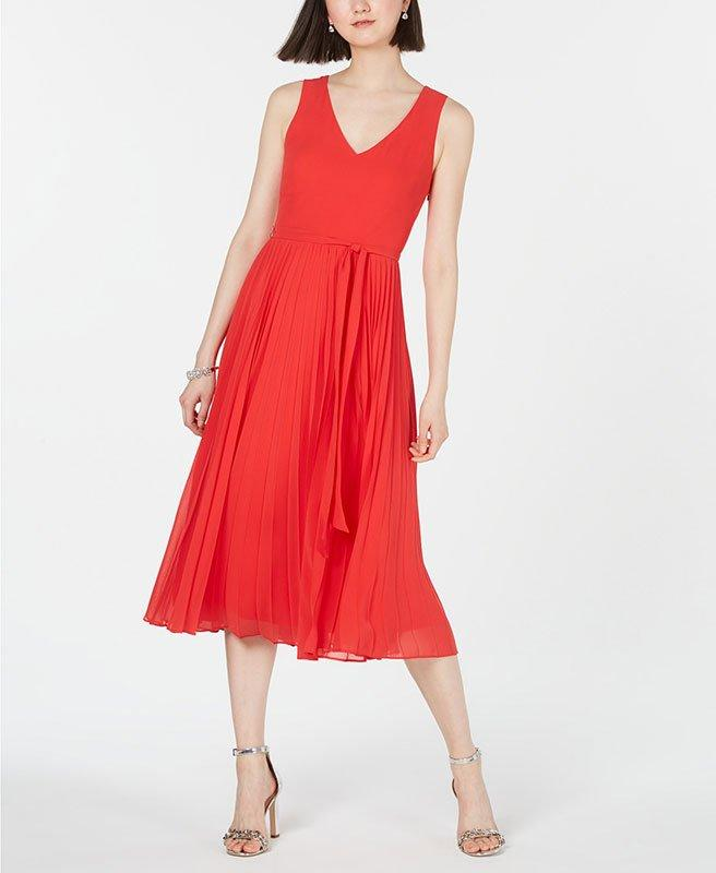 """<p>Make a statement in a breezy midi dress that looks just as posh at weddings as it does at brunch or in the office.</p> <p><strong>To buy:</strong> $80; <a href=""""https://click.linksynergy.com/deeplink?id=93xLBvPhAeE&mid=3184&murl=https%3A%2F%2Fwww.macys.com%2Fshop%2Fproduct%2Fi.n.c.-pleated-skirt-midi-dress-created-for-macys%3FID%3D8955252%26CategoryID%3D5449&u1=RS%2C5ChicDressesforSummerWeddingGuests%2Cagouras%2CDRE%2CDAI%2C368004%2C201907%2CI"""" target=""""_blank"""">macys.com</a>.</p>"""