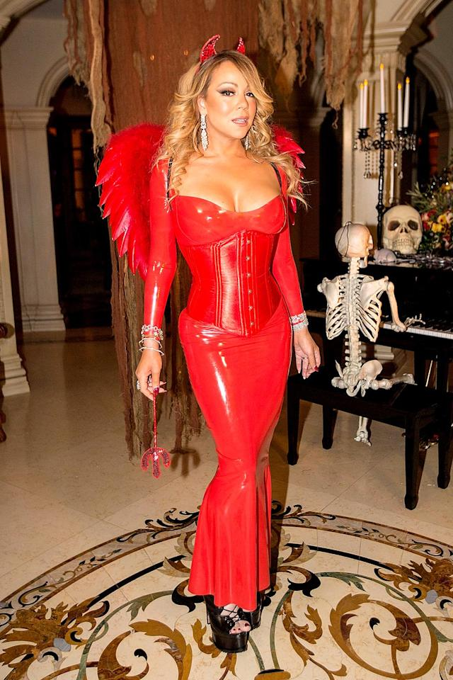 <p>The diva was red-hot in a sexy devil costume at <span>her annual Halloween party,</span> but she didn't change up her look too much. As always, Carey had plenty of cleavage on display. (Photo: FilmMagic/FilmMagic) </p>
