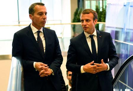 Austrian chancellor Christian Kern (L) and French President Emmanuel Macron arrive for a meeting at the Congress palace in Salzburg, Austria, August 23, 2017. REUTERS/Bertrand Guay