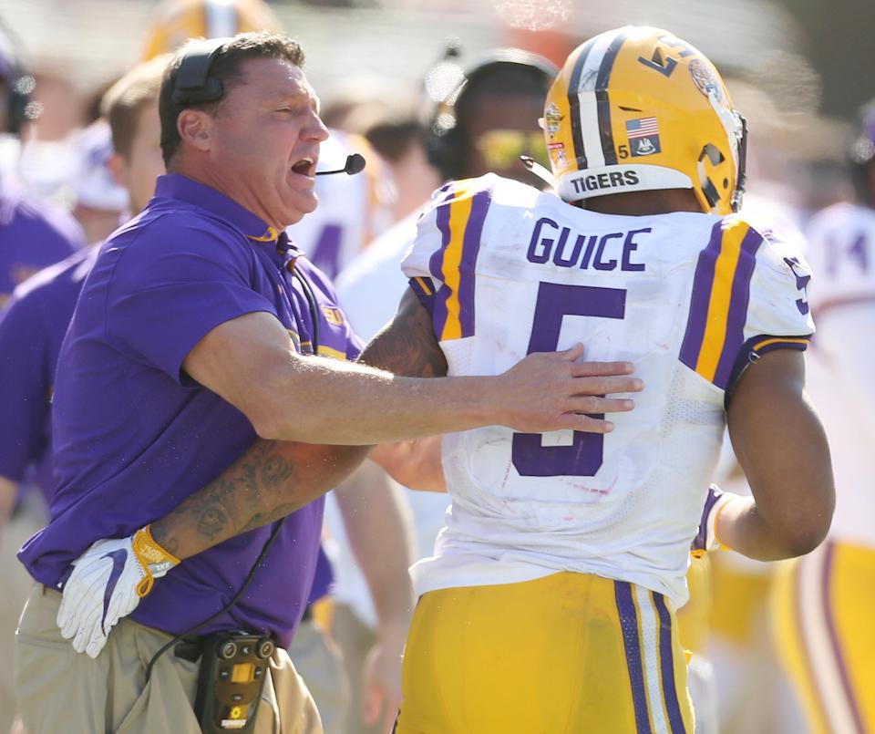 In the four years that Ed Orgeron (left) has been LSU head coach, no fewer than nine members of his Tigers teams have been reported to police for sexual misconduct and dating violence, including ex-running back Derrius Guice. (Stephen M. Dowell/Orlando Sentinel/Tribune News Service via Getty Images)