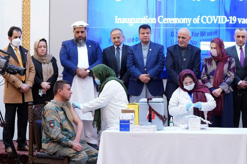Members of Afghan security forces receive the first dose of AstraZeneca's COVID-19 vaccine from India, in Kabul