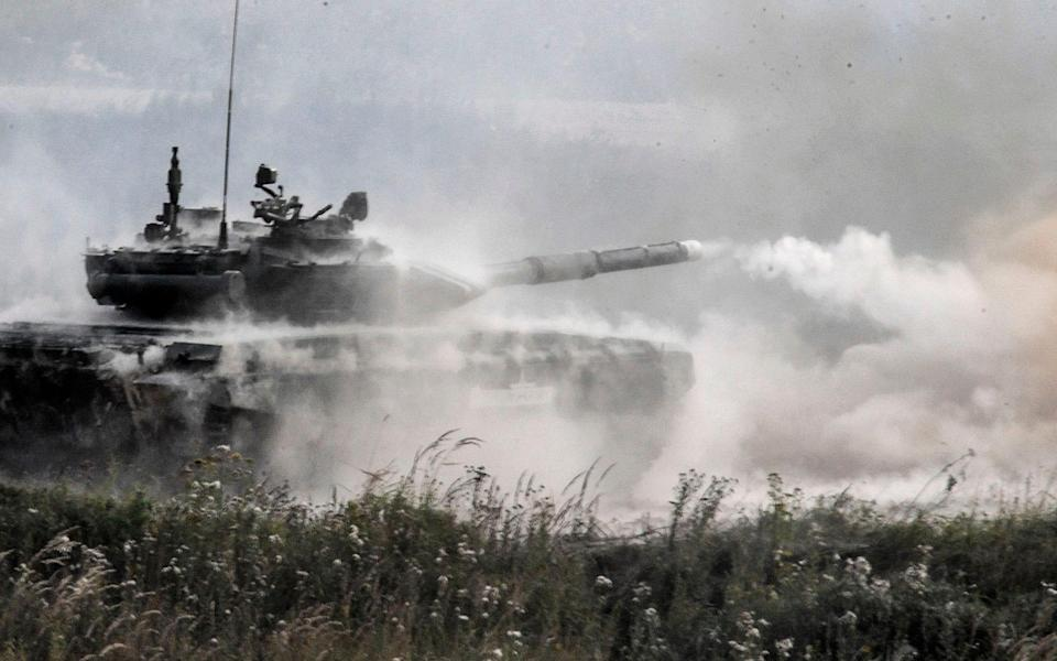 A Russian T-90 tank fires during a training exercise near Moscow - AFP