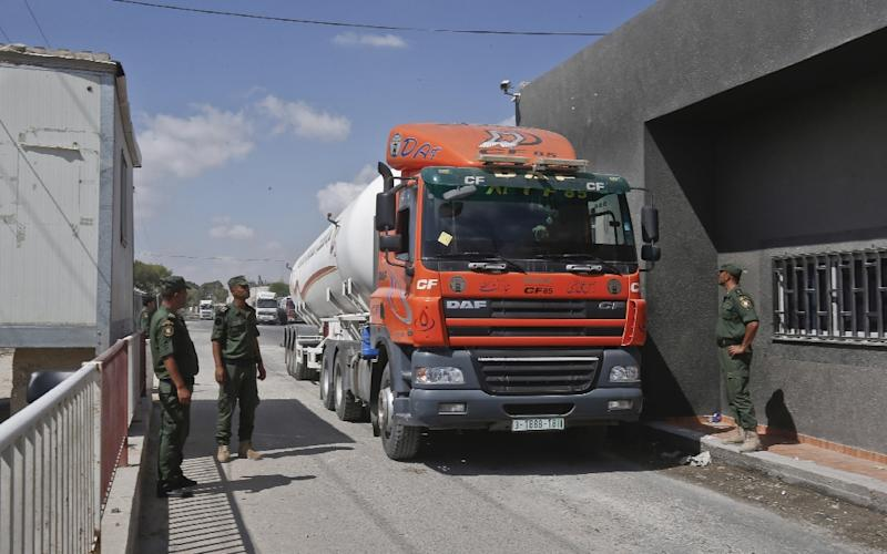 The Kerem Shalom goods crossing with Gaza (pictured) and the Erez crossing for people were closed after a rocket from the Palestinian territory hit a home in southern Israel