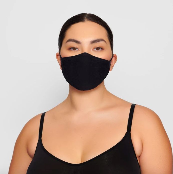 Adult Seamless Knit Face Mask in Onyx. Image via skims.com
