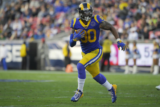 FILE - In this Dec. 29, 2019, file photo, Los Angeles Rams running back Todd Gurley runs a play during the first half of an NFL football game against the Arizona Cardinals, in Los Angeles. The Atlanta Falcons have agreed to a one-year deal with three-time Pro Bowl running back Todd Gurley, one day after he was cut by the Los Angeles Rams. A person familiar with the deal told The Associated Press about the agreement on Friday, March 20, 2020, on condition of anonymity because the deal will not be official until Gurley passes a physical. (AP Photo/Mark J. Terrill, File)