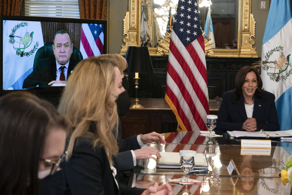Vice President Kamala Harris, right, meets virtually with Guatemala's President Alejandro Giammattei, seen on screen at left, Monday, April 26, 2021, from her ceremonial office at the Eisenhower Executive Office Building on the White House complex in Washington. (AP Photo/Jacquelyn Martin)