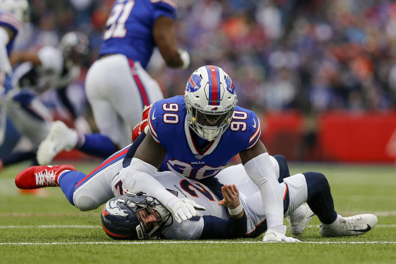 FILE - In this Nov. 24, 2019, file photo, Buffalo Bills defensive end Shaq Lawson (90) knocks Denver Broncos quarterback Brandon Allen (2) to the ground during the second quarter of an NFL football game in Orchard Park, N.Y. There won't be any accusations of tanking this year by the Miami Dolphins, who added up to seven starters with a spending spree at the start of free agency. Lawson had a career-high 6 1/2 sacks last year for the Bills. (AP Photo/John Munson, File)