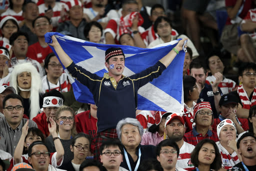 Fans cheer during the Rugby World Cup Pool A game at International Stadium between Japan and Scotland in Yokohama, Japan, Sunday, Oct. 13, 2019. (AP Photo/Jae Hong)