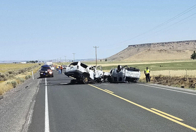 This Monday, Aug. 13, 2018 photo provided by the Oregon State Police shows the scene of a fatal car crash outside Burns, Ore. The collision in rural Oregon that killed eight people happened when the driver of one SUV crossed the centerline and crashed into another SUV carrying seven people. All the victims died at the scene. (Oregon State Police via AP)
